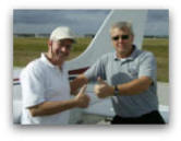 CFI and pilot after a successful flight training adventure